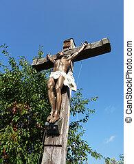 Jesus on y wood cross - Jesus on a wood cross with blue sky