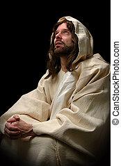 Jesus Praying - Jesus in prayer over a dark background