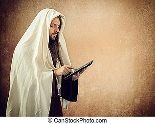 Jesus uses the tablet - Jesus Christ reads the Holy Bible...