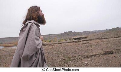 Jesus walks on rocky terrain