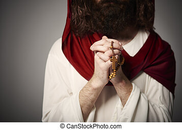Jesus with folded hands and rosary