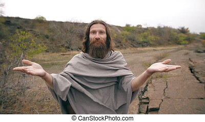 Jesus with open hands on nature