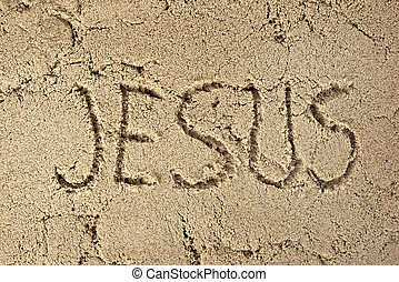 Jesus written in beach sand