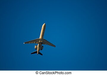 Jet airliner against blue sky