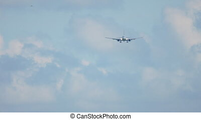 Airplane approaching before landing on runway 18R. Airport of Amsterdam, Netherlands