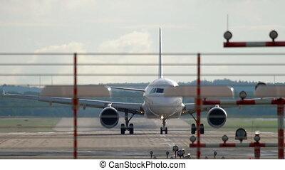 Jet airplane braking after landing