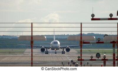 Jet airplane braking after landing in Dusseldorf Airport