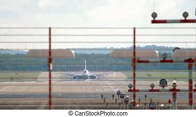 Jet airplane landing and braking in Dusseldorf