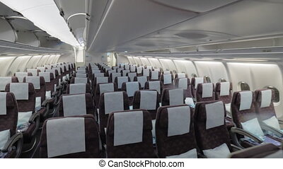 Jet airplane economy class interior view - Wide shot of a...