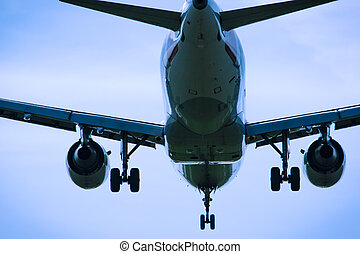 Jet airplane flying overhead close-up