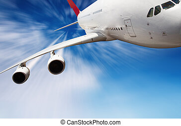 Jet airplane in the sky with motion blur