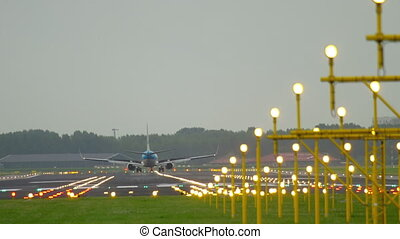 Jet airplane landing on runway 18R at morning. Airport of...