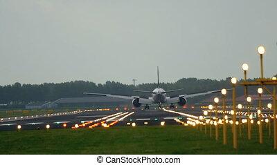 Jet airplane landing - Widebody jet airplane braking after...