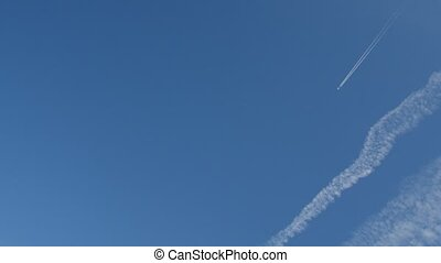 Jet airplane with trail against the blue sky - Jet airplane...
