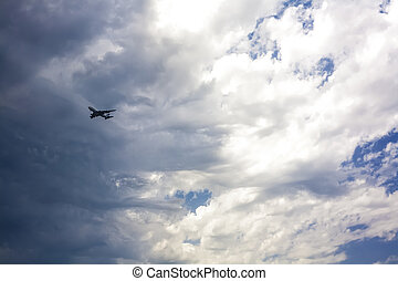 Jet approaching against a stormy sky