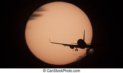 Jet approaching to landing with sun behind it - Silhouette...