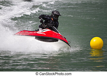 Close view of a jet boat race in the pier of Portimao city, Algarve, Portugal.