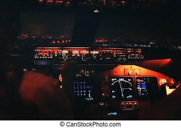Jet cockpit and runway lights during a night landing