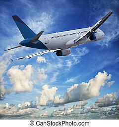 Jet cruising in a blue cloudy sky