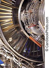 jet engine maintenance - large jet engine parts exposed for...