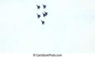 ZHUKOVSKY, RUSSIA - AUGUST 20: jets display team fly in formation during MAKS-2011 airshow on August 20, 2011 in Zhukovsky, Russia