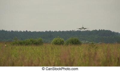 jet fighter landing on air field