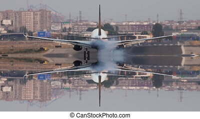 Jet landing in super slow motion, rear view - Rear view of...