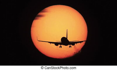 Jet landing with sun behind it in super slow motion -...