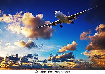 Jet maneuvering in a sunset sky