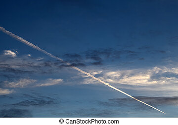 Jet of airplane in the blue sky
