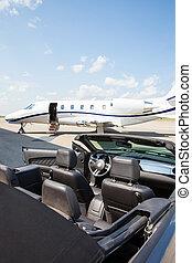 Jet Plane And Convertible At Terminal