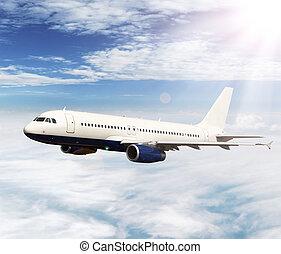 Jet plane - Big jet plane flying above clouds