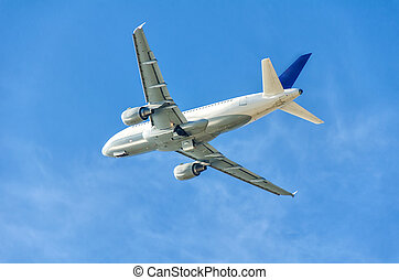 Jet plane flying on blue sky