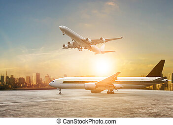 jet plane flying over runways and beautiful dusky sky with copy space use for air transport ,journey and traveling industry business