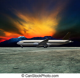 jet plane flying over runways and beautiful dusky sky with copy