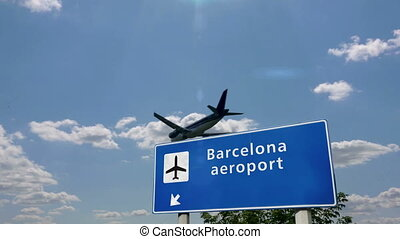 Jet plane landing in Barcelona, Spain, Catalonia. City arrival with airport direction sign. Travel, business, tourism and transport concept.