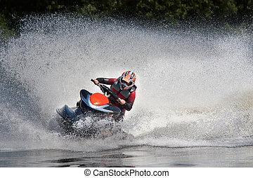 Jet ski in action - Man Riding Jet Ski Personal Watercraft