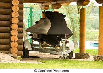 Jet ski in garage - Covered jet ski in garage