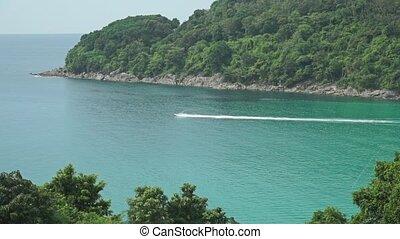 Jet ski moving fast across Phuket bay, Thailand