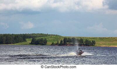 Jet-ski on lake in summer day