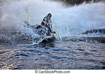 jet ski at high speed lifts a large wave