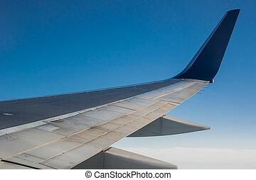Jet Wing on Blue Sky