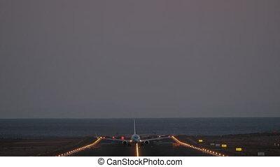 Jetliner taking off in the dusk