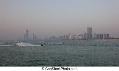 Abu Dhabi skyline - Jetski riders in front of the Abu Dhabi...