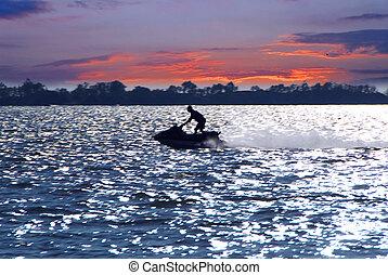 Jetski - Man on jet ski at sunset