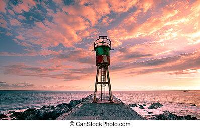 jetty and lighthouse in Saint Pierre, La Reunion island, Indian Ocean, april 26, 2016, Saint Pierre, France