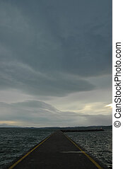 jetty and stormy cloud