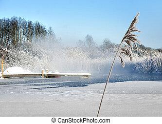 Jetty in lake in winter