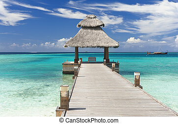 Jetty in the Maldives - Wooden jetty over the beautiful ...