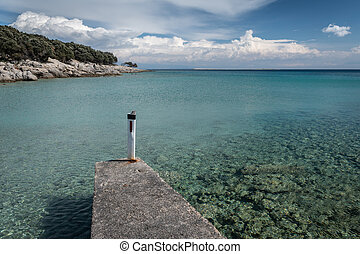 Jetty in the small port of Verin on a sunny day in spring